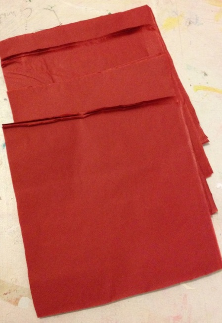 Cut your tissue paper into a stack of squares